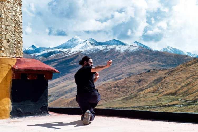 man doing martial arts outside