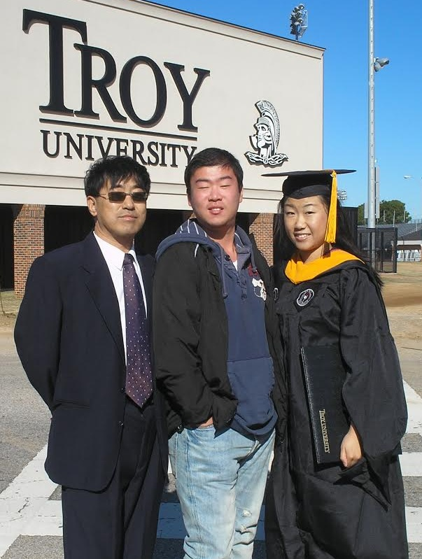 Haijiao Sun (middle) graduated from Troy in Dec. 2013.