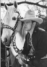 Cowboy movie star Buck Jones with his horse Silver