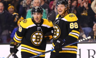 Boston Bruins F's David Pastrnak and Brad Marchand