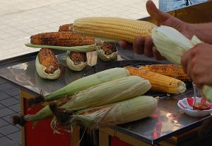 Selling corn on the cob in a street market