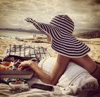 4. Woman in striped black oversize hat