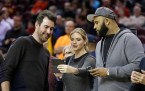 Detroit Tigers pitcher Justin Verlander, from left, model Kate Upton, and New York Yankees pitcher CC Sabathia stand on the court before an NBA basketball game between the Milwaukee Bucks and the Cleveland Cavaliers, Tuesday, Dec. 2, 2014, in Cleveland. The Cavaliers defeated the Bucks 111-108. (AP Photo/Tony Dejak)