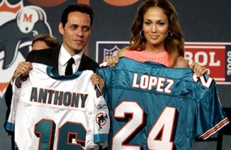 Marc Anthony and Jennifer Lopez hold up Miami Dolphins jerseys during a news conference Tuesday, July 21, 2009, announcing his minority ownership in the team in New York. (AP Photo/Mary Altaffer) Original Filename: APTOPIX_Dolphins_Marc_Anthony_NYMA103.jpg