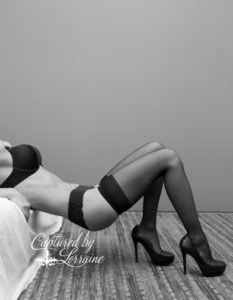 Black and white boudoir bed pose