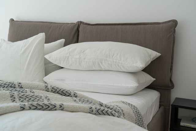 white pillows on a bed in a good hosts' guest room