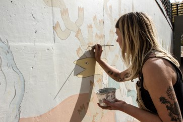 Katherine Rutter at work on Martin Drive Mural (photo by Lauren Click)