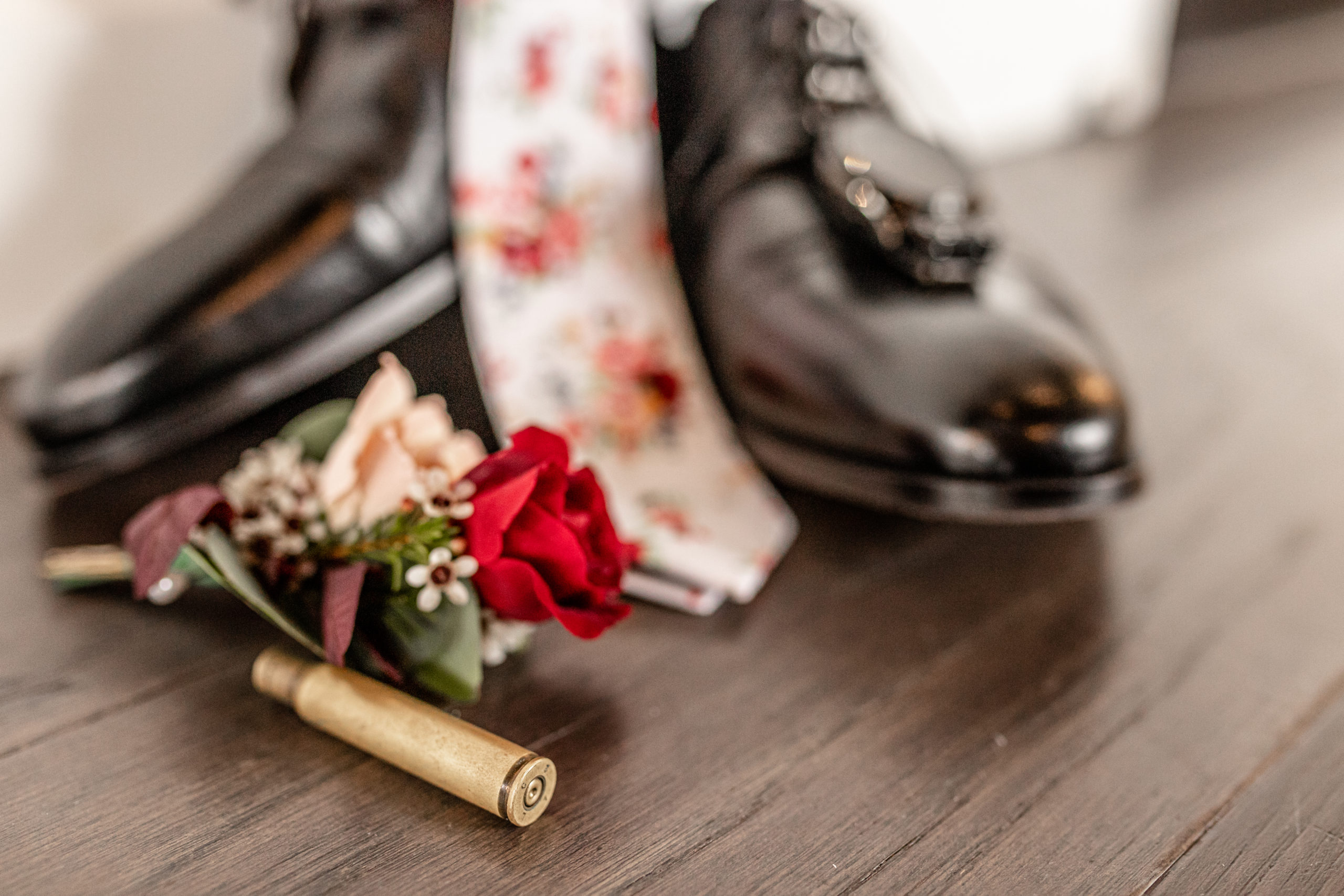 wedding details, red rose boutonniere, grooms wedding detail, bullet casing, rusty rose