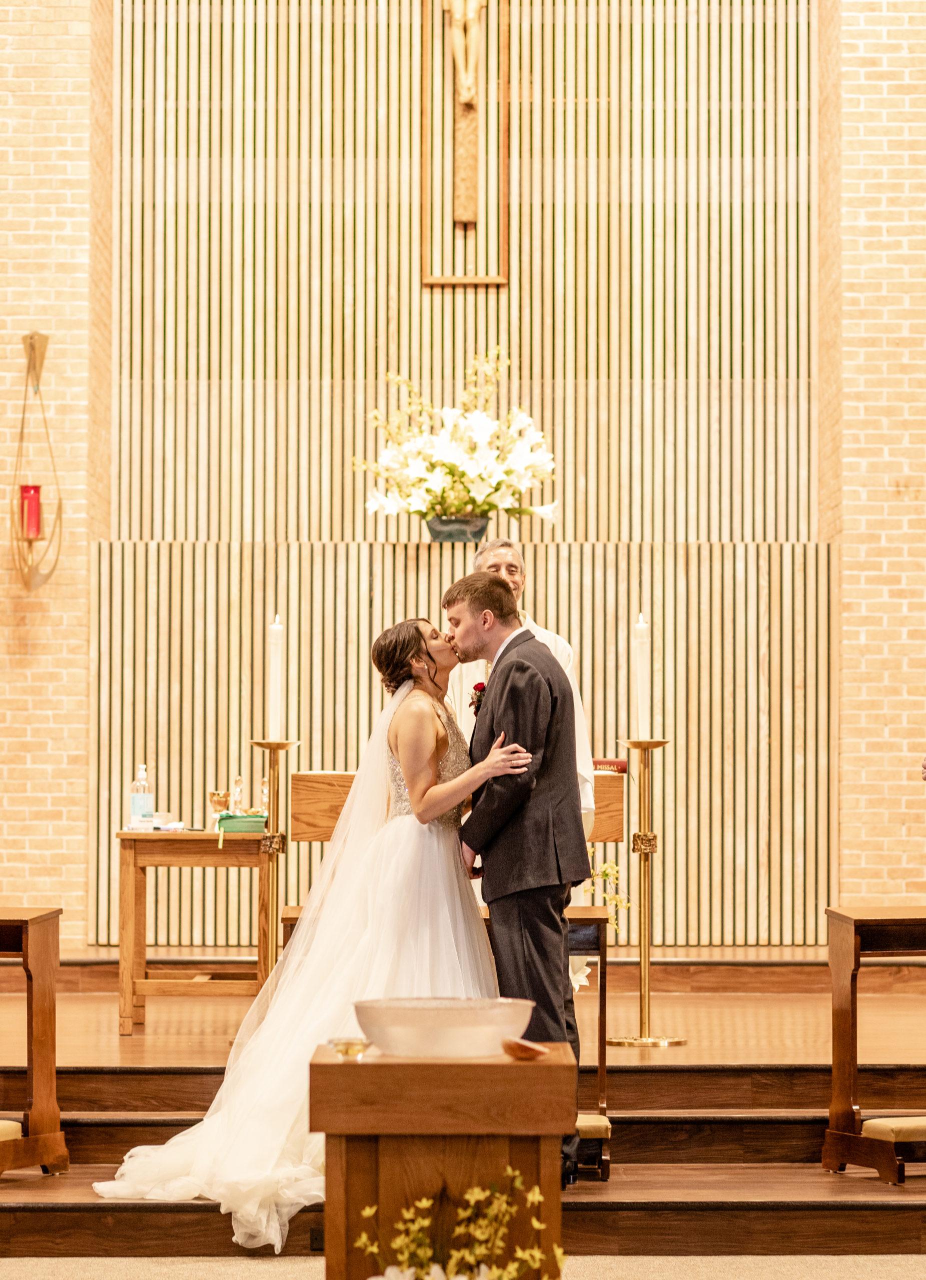 church wedding, bride and groom, kissing,