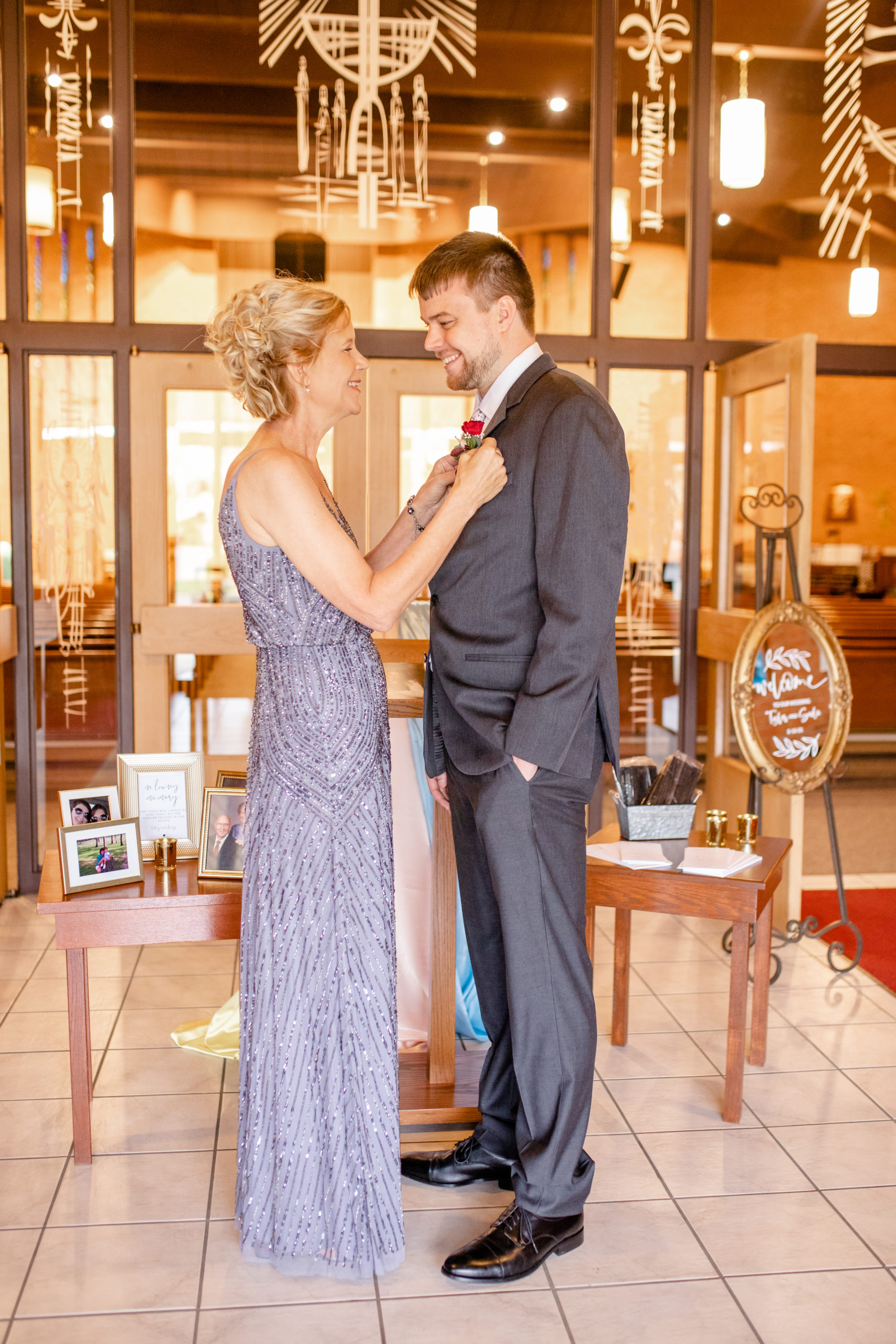 groom, mother of the groom, groom, pinning the boutonniere