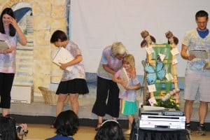 Boulder JCC Pre-K Owl receives her diploma from teacher Caroline Saliman.