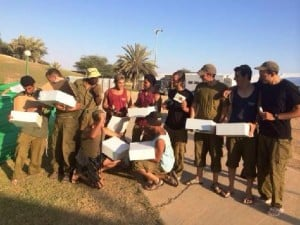 IDF Soldiers receive some of the 5000 packages boxed by JNF and other volunteers