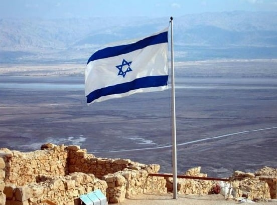 Israel's flag flying atop Masada.
