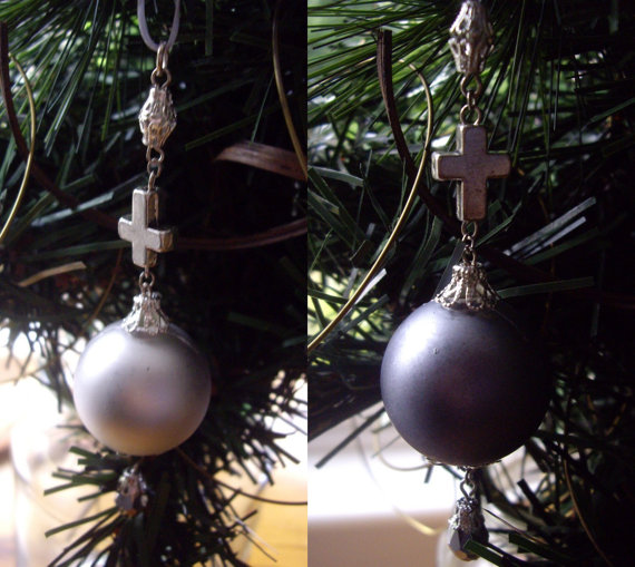 for a more traditionally gothic christmas tree these baubles are perfect the black and gold keep it classy but the upside down cross detail and jewel