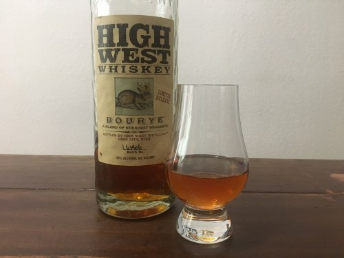 High West Bourye bottle and glencairn glass on table