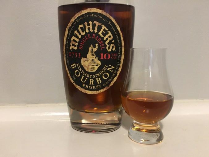 Bottle of Michter's single barrel Bourbon with glencairn glass
