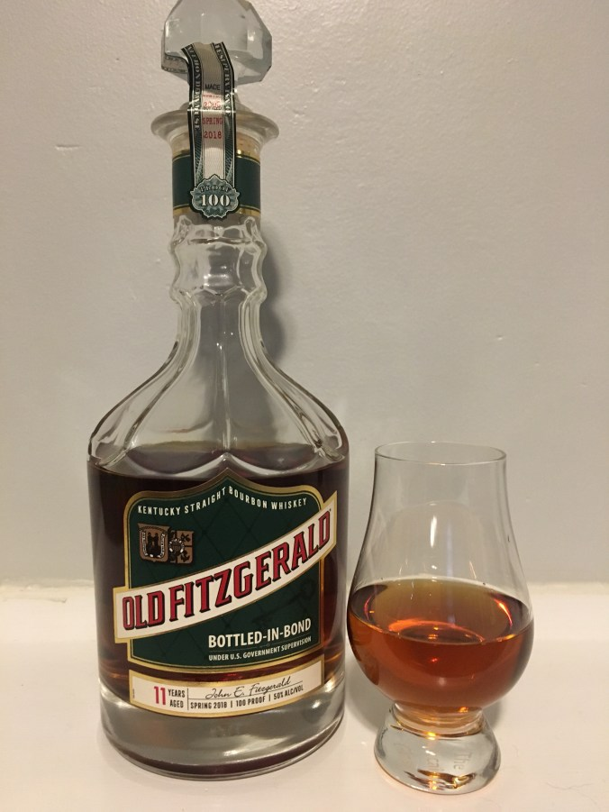 Bottle of Old Fitzgerald with glencairn glass.