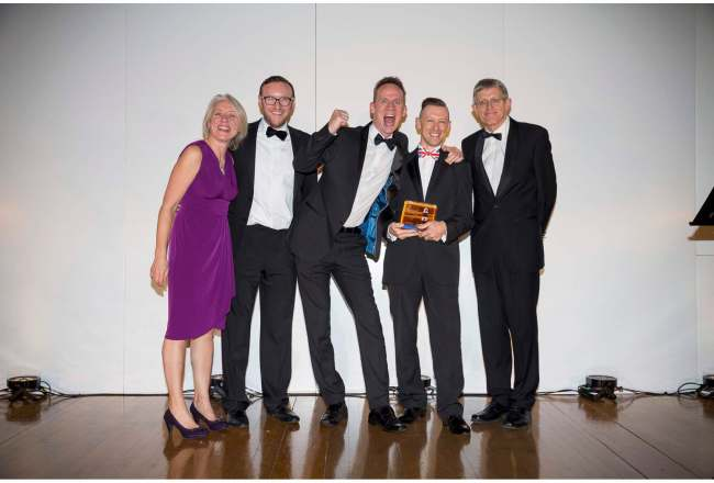 Andy and Julian Banner-Price collecting their recent award for best boutique B&B