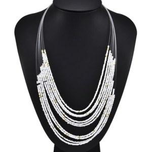 Sautoir petites perles blanches