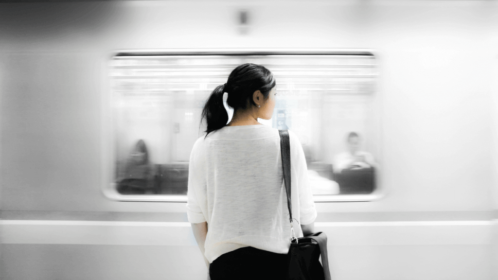 A woman waits for a train in the Tokyo metro, Japan