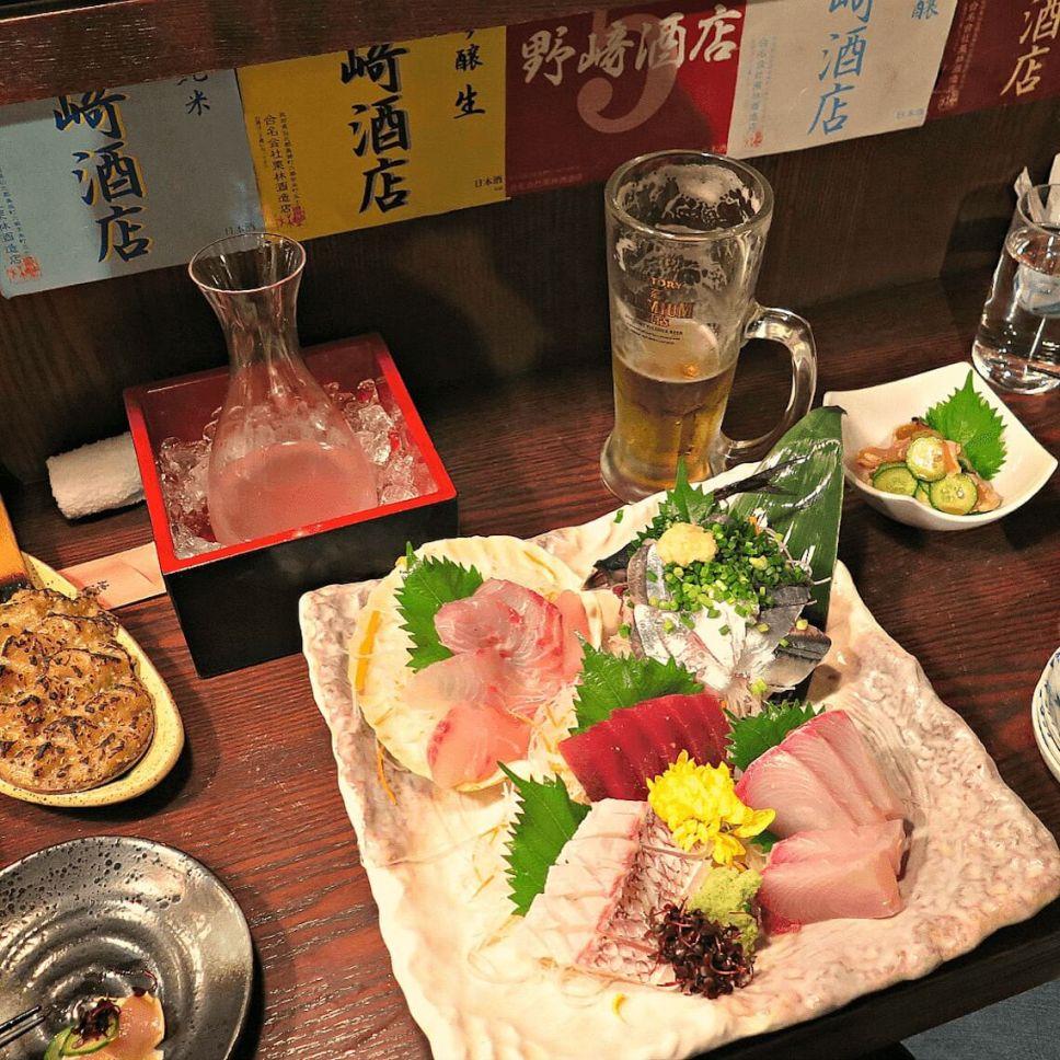 Sake and sashimi at an izakaya in Shimbashi, Tokyo