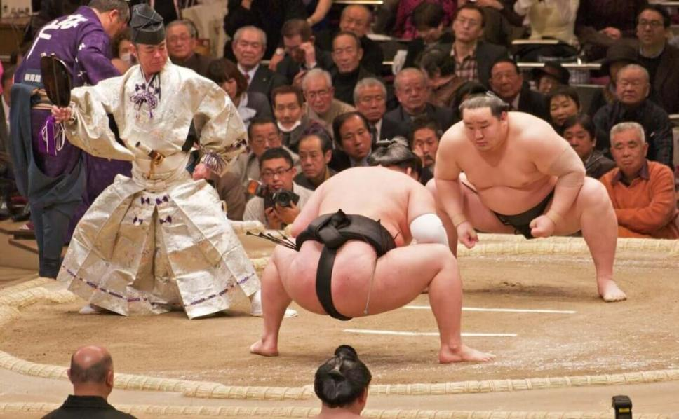 Sumo wrestlers (rikishi) face off at a tournament (basho) in Japan