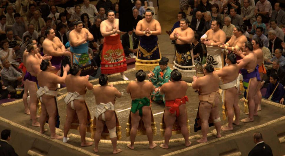 Sumo (rikishi) gathering around the ring (dohyo) before a tournament (basho)