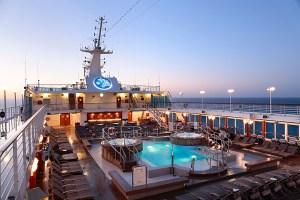 Pool Deck at sunrise on the boutique luxury cruiser, Azamara Journey