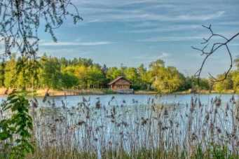 Quirky hotels in the UK | Log cabin by a lake