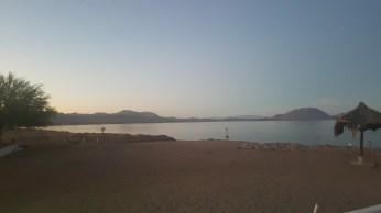 Sun sets over the mountains; Sea of Cortez
