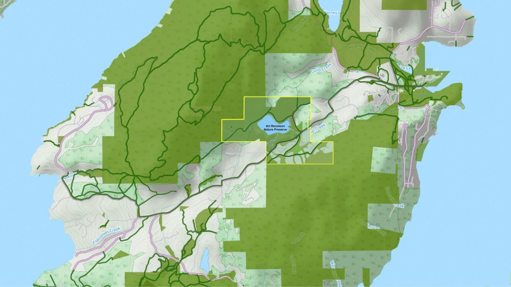 Map of central Bowen Island showing how green spaces on the Eco Reserve and Mount Gardner are connected with large green spaces around the lake, and wildlife corridors through the residential areas.
