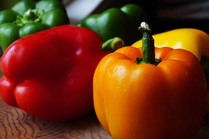 Red, yellow, orange and green bell peppers.