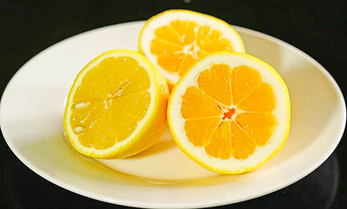 Sliced lemons on a white plate