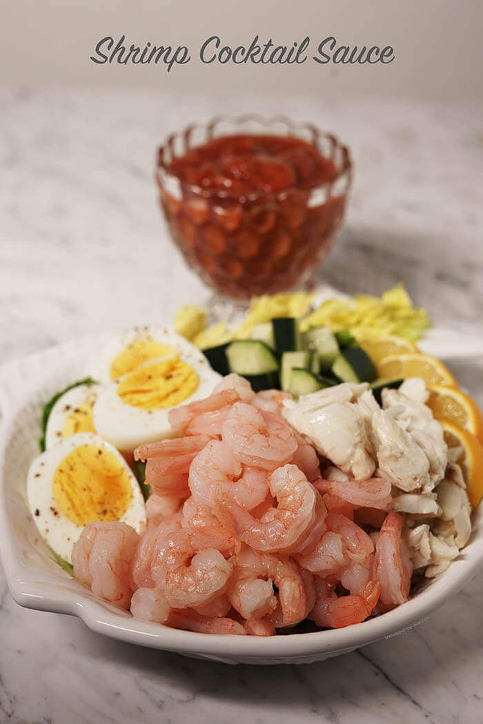 A plate of shrimp, crab and eggs with cocktail sauce #ShrimpCocktailSauce #BowlMeOver