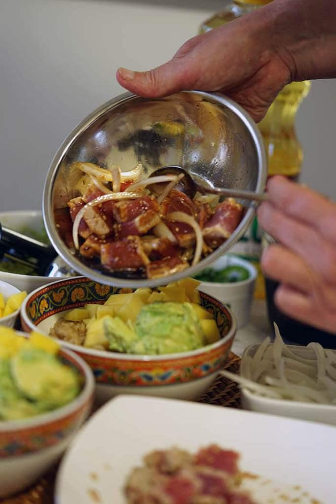 Seared tuna topping off a rice bowl.