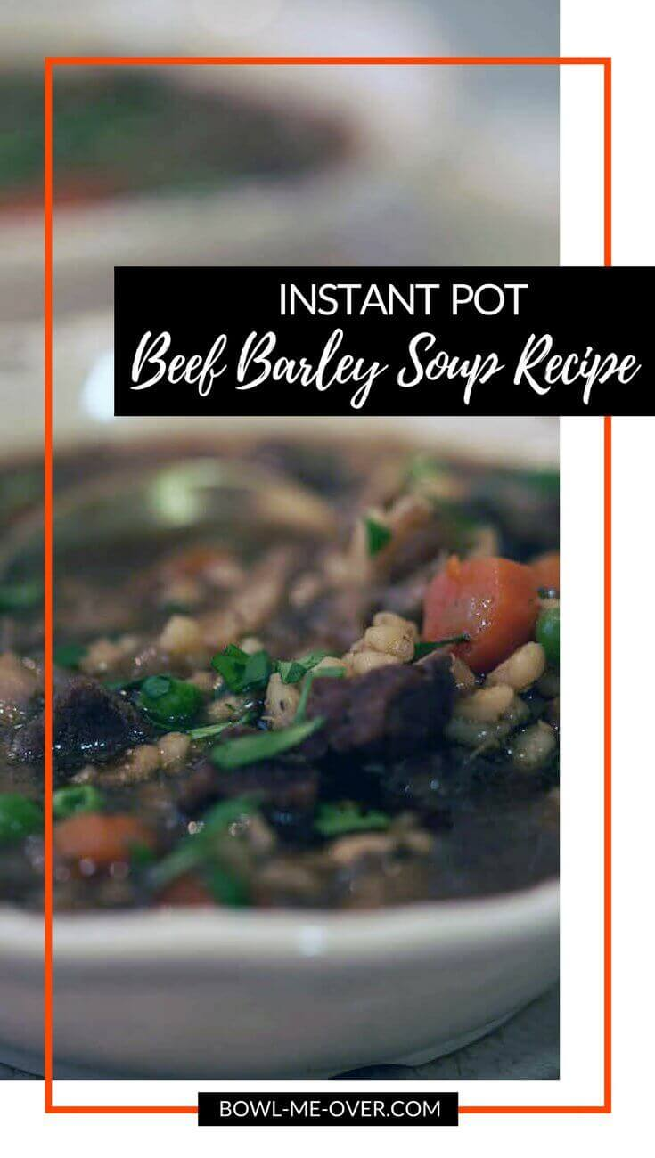 A white bowl full of delicious and hearty Beef Barley Soup!