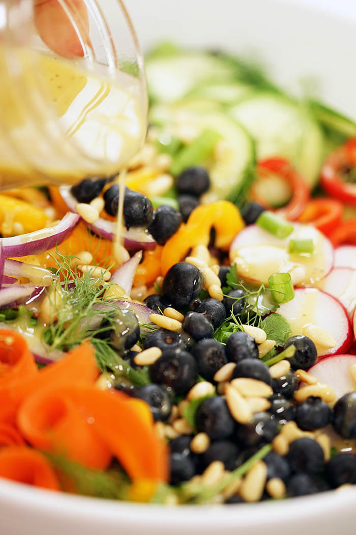 A fresh green salad recipe topped with homemade vinaigrette!