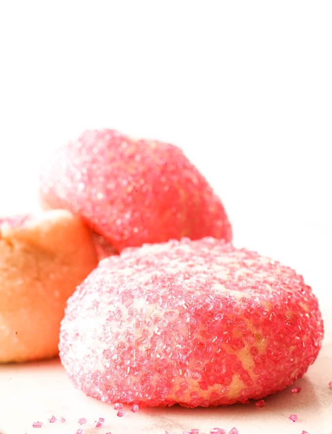 Three sugar cookies rolled in pink sugar.