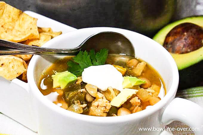 White Bean Turkey Chili in white bowl with spoon