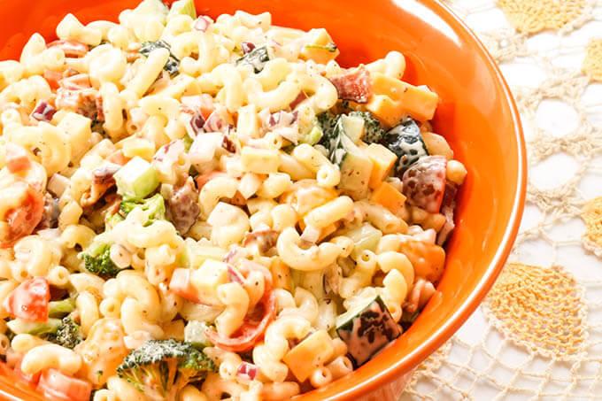 Macaroni and Cheese Pasta Salad Recipe in orange bowl.