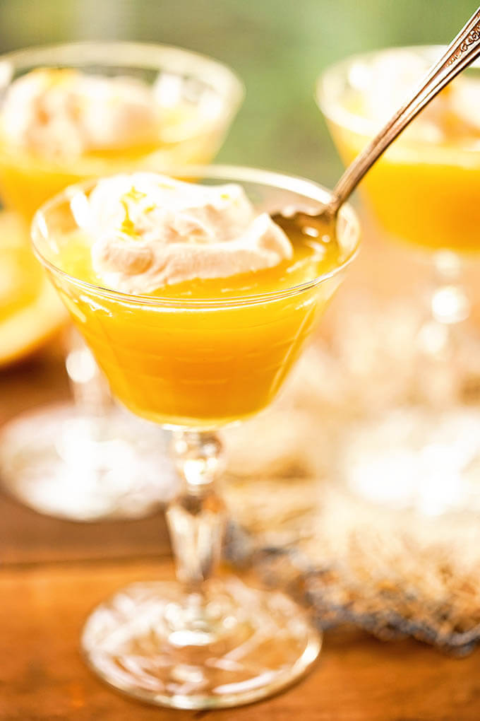Meyer Lemon Curd served with a dollop of whipped cream.