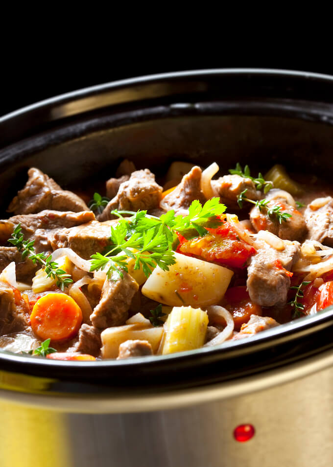 Beef stew cooking in crockpot.
