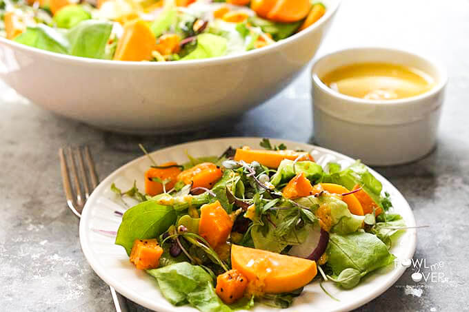 Fall Harvest Salad on white plate with homemade dressing.