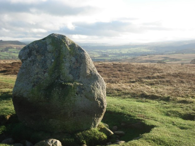 The Cop Stone with distant Shap and the Howgills.