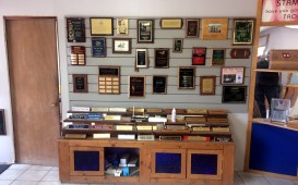 Display of plaque designs, layouts, & fonts & graphics used to enhance plaque design. It also shows different type of plaque shapes and materials.
