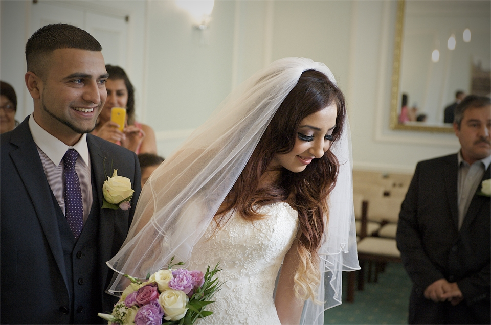 Moment during the ceremony of the wedding of Adnan and Jasmina by the cambridge based photographer and illiustrator Richard Bowring