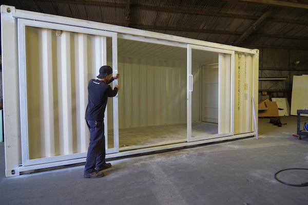man pushing sliding glass double doors