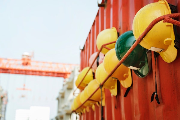 shipping container workshop with hardhats