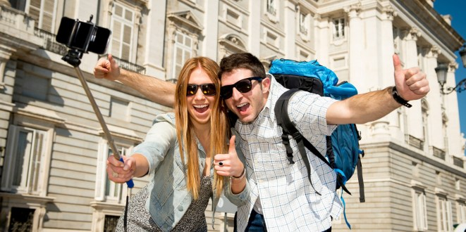friends tourist couple visiting Spain on holidays taking selfie picture
