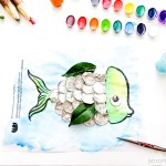 Cute fish made with watercolour and tin foil from a free printable #eyfs #earlyyears #kindergarten #crafts